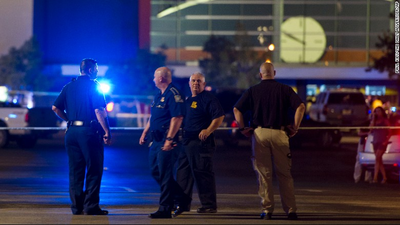 Police respond to movie theater shooting. Photo Courtesy of CNN.