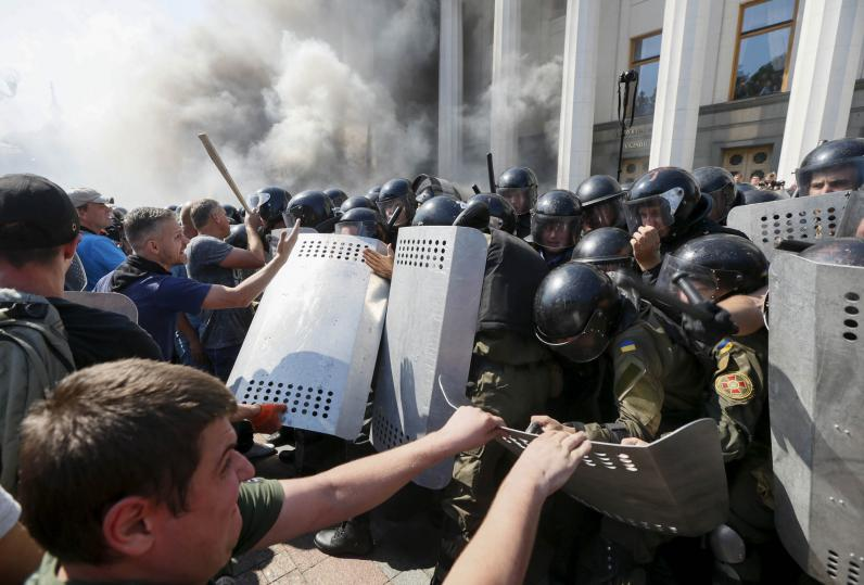 August 31, 2015 Police and Protesters clash outside of Parliament in Kiev, Ukraine. Image Courtesy of Newsweek.com.