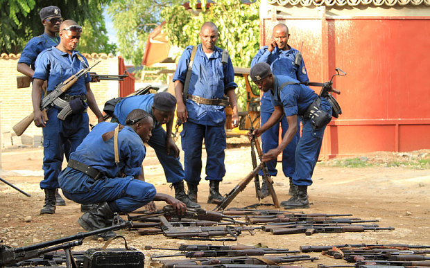 Burundian police collect weapons from suspected fighters in Bujumbura, Burundi. Image Courtesy of telegraph.co.uk.