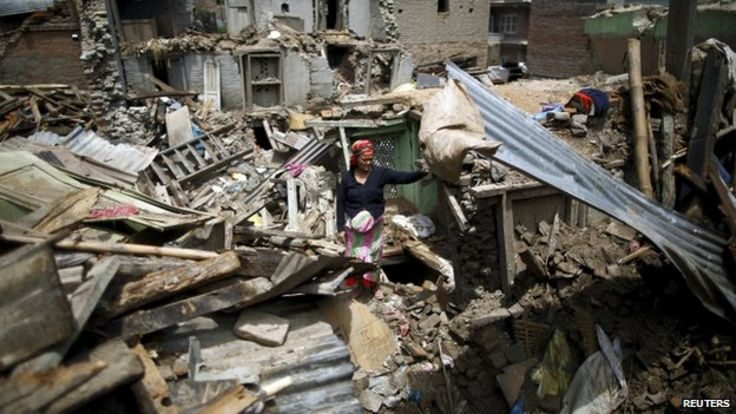 Kathmandu buildings brought down by the earthquake in Nepal on April 25, 2015. Image Courtesy of Reuters via www.bbc.com.
