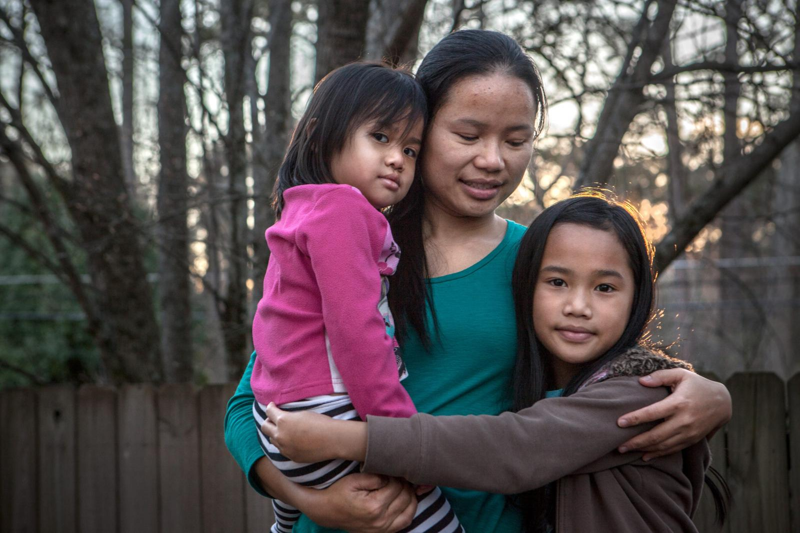 Klaw Htoo and her daughters Gloria and Sophia lived in a refugee camp in Thailand for nine years when they fled from Myanmar. Image Courtesy of rescue.org
