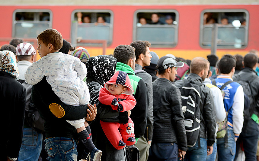 Refugees at rail station in the Macedonian border town of Gevgelija. Image Courtesy of telegraph.co.uk.