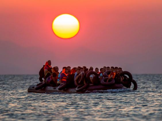 Refugees cross from Turkey to Greece in a dinghy. Image Courtesy of independent.co.uk.
