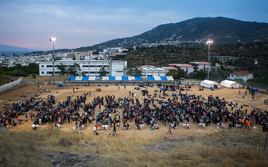 Refugees register at a football stadium in Mytilene, on the Greek island of Lesbos. Image Courtesy of telegraph.co.uk